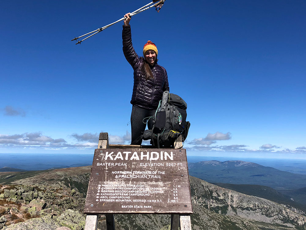Devin Taylor at the northern terminus of the Appalachian Trail in Maine